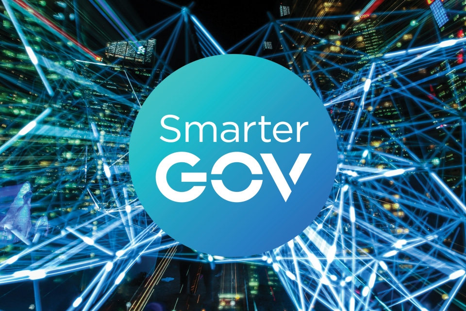 Image of smarter gov logo, with background of skyscrapers and lines indicating the transfer of data